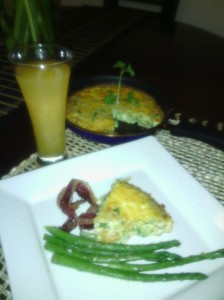 A wedge of my first Frittata along with bacon/asparagus and fresh OJ