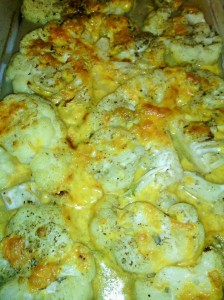 Final dish of cauliflower with melted cheddar cheese topping