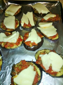 GRILLED EGGPLANT SLICES TOPPED WITH HOMEMADE TOMATO SAUCE/MOZZARELLA CHEESE READY FOR MELTING UNDER BROILER