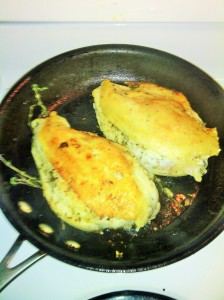 CHICKEN BREASTS BEING SEARED WITH THYME