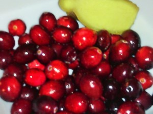 FRESH CRANBERRIES AND GINGER ROOT