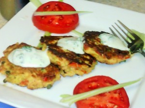 SALMON CAKES WITH A SOUR CREAM/RANCH DRESSING AND TOMATO SLICES/CELERY STICKS