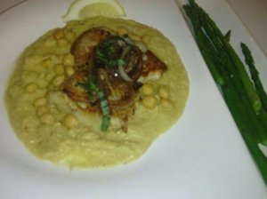 FINISHED DISH OF PAN-SEARED TARRAGON FLOUNDER ON A BED OF PUREED CHICKPEAS AND SERVING OF ASPARAGUS