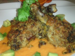 PLATED DISH OF HERB & CHEDDAR CRUSTED ROAST CHICKEN ON CARROT/GINGER SAUCE WITH GARNISH OF CILANTRO/AVOCADO