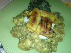 CURRIED CHICKEN DISH ALONG WITH STEAMED WHOLE WHEAT RICE, SAUTEED KALE AND FRIED PLANTAIN
