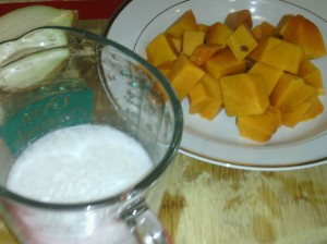 CHOPPED PUMPKIN PIECES AND COCONUT MILK