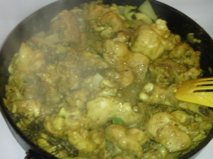 CURRIED CHICKEN IN SKILLET READY FOR COOKING