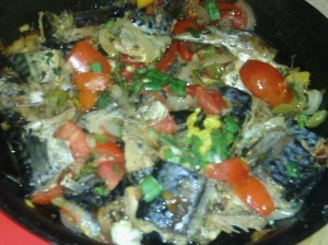 SAUTEED PICKLED MACKEREL WITH TOMATOES, BELL PEPPERS, ONIONS,STOCK BONNET PEPPERS