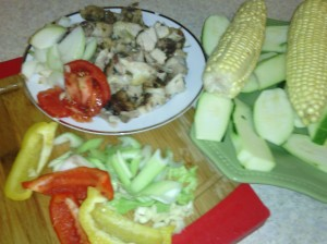PREPPING FOR STIR-FRYING LEFT-OVER THIGH/WING ALONG WITH CORN ON THE COB, ZUCCHINI, BELL PEPPERS AND OTHER INGREDIENTS