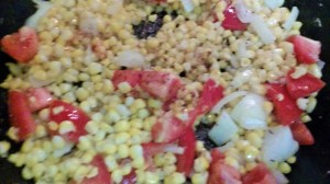 PAN-ROASTED CORN ALONG WITH TOMATOES AND ONION