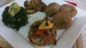 SAUTEED PICKLED RED HERRING SERVED WITH WHOLE-WHEAT FRIED DUMPLINGS, STEAMED CALLALOO (JAMAICAN SPINACH) AND FRIED PLANTAINS