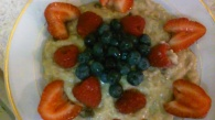 OATMEAL AND RAISINS ALONG WITH FRESH BERRIES
