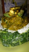 CURRIED CHICK THIGHS OVER A BED OF JASMINE RICE/GARLIC SPINACH ....TOPPED WITH AVOCADO & FRIED PLANTAIN