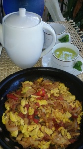 WARM MINT TEA ALONG WITH ACKEE AND CODFISH IN SKILLET