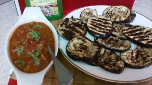 GRILLED EGGPLANT ALONG WITH HOME-MADE TOMATO SAUCE AND FETA CHEESE