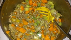 LENTILS AND ROOT VEGGIES BEING SAUTEED