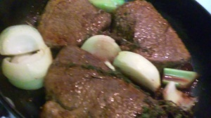 CHUNK STEAK AND OTHER INGREDIENTS IN SKILLET FOR BRAISING