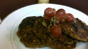 FINISHED BANANA AND OATMEAL PANCAKES TOPPED WITH FRESH STRAWBERRIES
